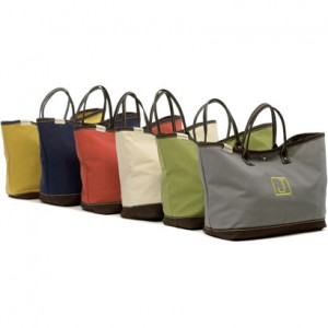 The new Captain Louis tote by Henry Brown is a must have in every household. This large stylish canvas bag is an ideal choice whenever you need a bag to carry a lot of stuff; beach towels, ski jackets, weekend toys, riding boots, tennis or gym clothes. With a bit more style than a LL Bean tote, this bag is a nice alternative. The Captain Louis is made of durable all canvas exterior, finished out with handles and a bottom in bourbon barrel brown. Inside is finished with a brown and white stripe and is trimmed with a coordinating velvet ribbon. Each Captain Louis Tote Bag measures an oversized 26 x 17. It is available in 7 colors each with cream colored top stitching. Features a single interior zipper pocket; an easy top tabbed closure.